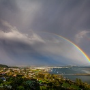 Double rainbow, Knysna Lagoon.  Actual view from Paradise Found. Photo by Chris Daly.