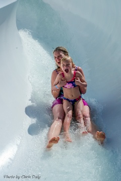 Enjoying the excitement of a super water slide at Adventure Land