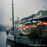 Yacht outside 34 South. Knysna Waterfront on a misty morning.