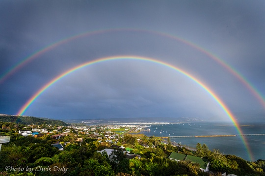 Colourful rainbow over Knysna. Actual view from Paradise Found. Photo by Chris Daly.