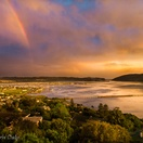 Knysna Lagoon, Sunset with rainbow.   Actual view from Paradise Found. Photo by Chris Daly.