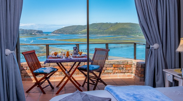 Actual view from the Bed and breakfast bedroom over the Knysna lagoon, harbor and Knysna Heads